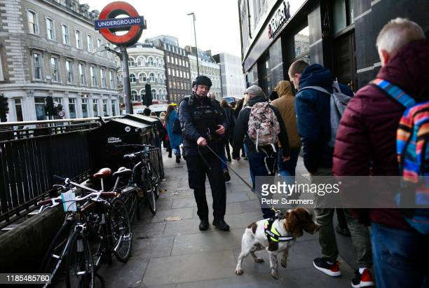 Metropolitan Police officer with a sniffer dog patrols near Borough Market after a number of people are believed to have been injured after a...