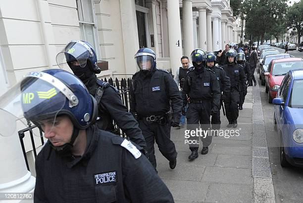 Metropolitan Police officers carry out a raid on a property on the Churchill Gardens estate in Pimlico in London on August 11, 2011 during Operation...