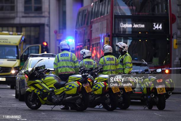 Metropolitan Police officers gather near Borough Market after a number of people are believed to have been injured after a stabbing at London Bridge...
