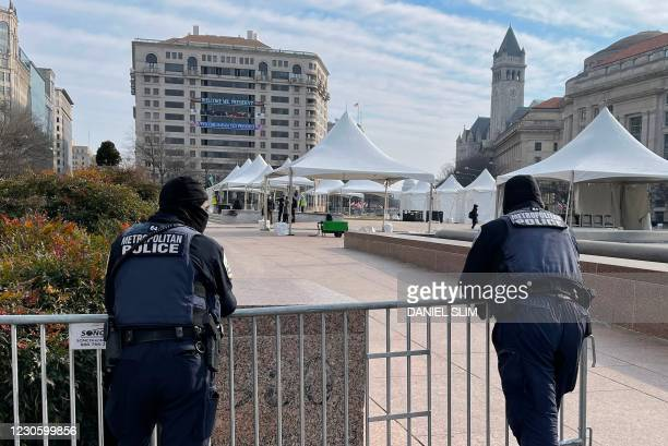 Metropolitan police officers patrol Freedom Plaza near the White House in Washington, DC, on January 15 five days before the inauguration of US...