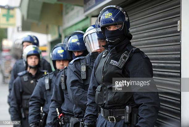 Metropolitan Police officers prepare to carry out a raid on a property on the Churchill Gardens estate in Pimlico during Operation Woodstock on...