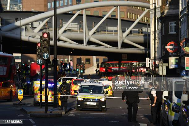 Metropolitan Police officers set up a cordon near Borough Market after a number of people are believed to have been injured after a stabbing at...