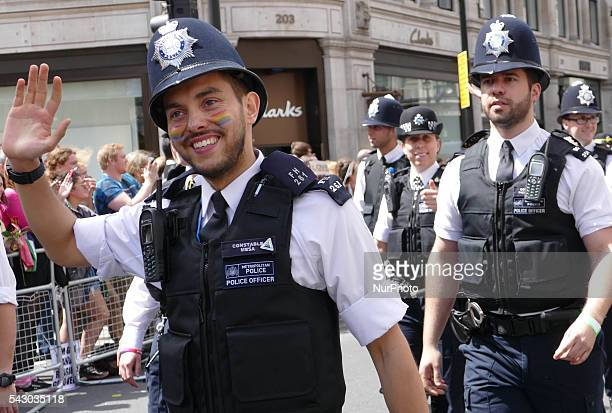 Metropolitan Police officers share a joke during the Pride march as the LGBT community celebrates Pride in London on June 25 2016 in London England...