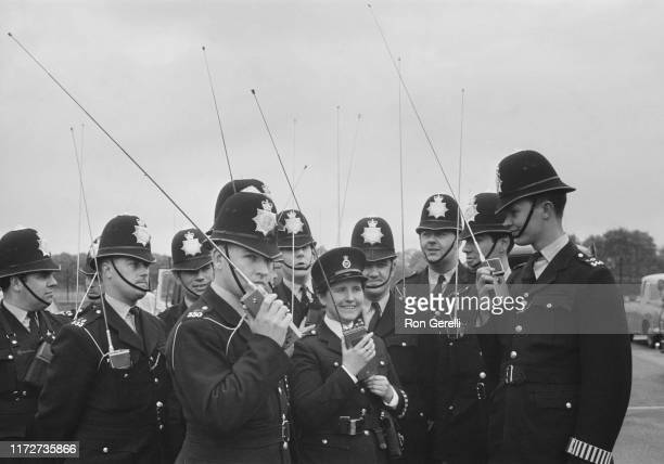 Metropolitan Police officers using the new City of London Police walkietalkie radios among them Police Constable Margaret Raymond the first woman to...