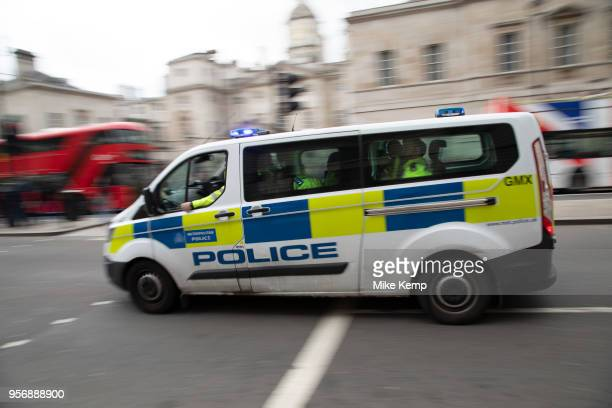Metropolitan police van passes at speed on Whitehall in London United Kingdom The service responsible for law enforcement within Greater London is...