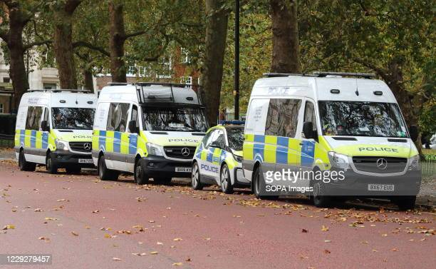 Metropolitan Police vans and cars are parked on Horseguards Road behind Whitehall prepared for the march demonstrations. With a number of expected...