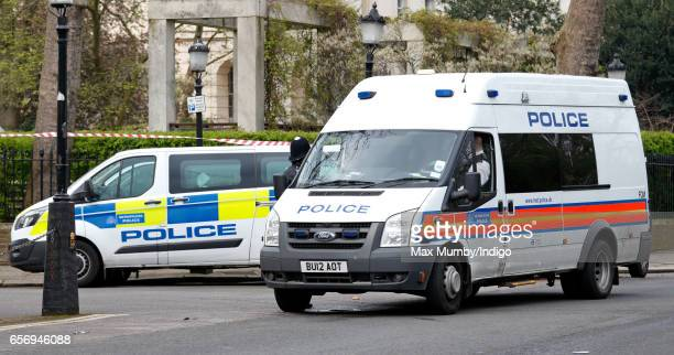 Metropolitan Police vehicles seen outside the Royal College of Obstetricians and Gynaecologists ahead of a visit by Catherine Duchess of Cambridge to...