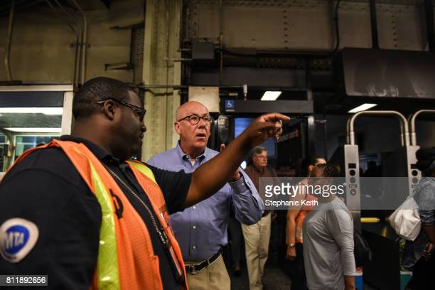 Metropolitan Transit Authority employee helps a commuter transfer from Long Island railroad service to a New York City subway at the Barclays Center...