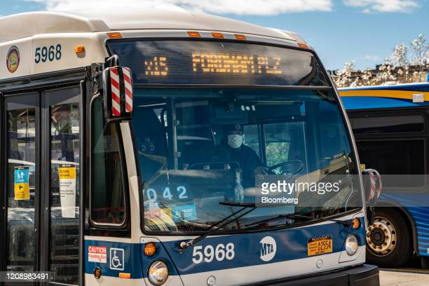 Metropolitan Transportation Authority driver wears a protective mask while driving a bus in the Bronx borough of New York, U.S., on Thursday, April...