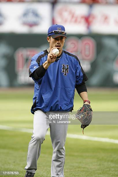 Mets 2nd baseman Kazuo Matsui warms up prior to action between the New York Mets and the St Louis Cardinals at Busch Stadium in St Louis Missouri on...