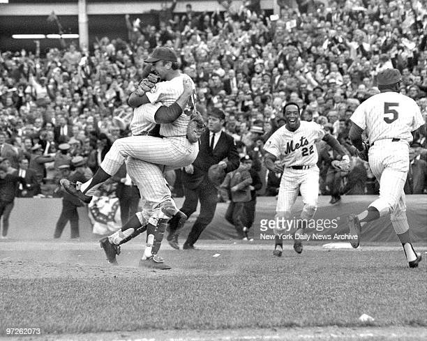 Y Mets defeat the Baltimore Orioles 53 in Game 5 of the 1969 World Series Mets winning pitcher Jerry Koosman jumps on his batterymate Jerry Grote...