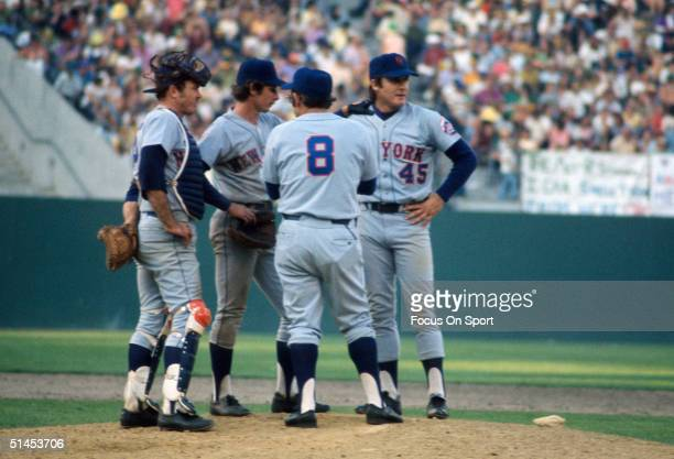 Mets' Jerry Grote, Bud Harrelson, and Yogi Berra meet reliever Tug McRaw at the mound during the 1973 World Series at the Oakland - Alameda Coliseum...