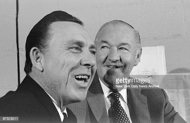 Mets' manager Gil Hodges left] and general manager Johnny Murphy beam after announcement that manager's contract has been extended three more years