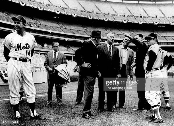 Mets manager Gil Hodges Who knows Shea Stadium groundrules stands aside as Baltimore manager Earl Weaver listens to a cluster of umpires and...