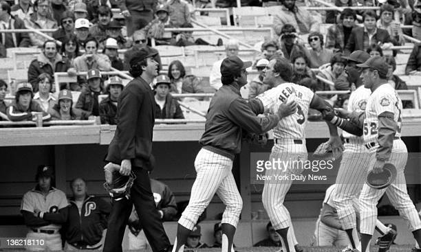 Mets' manager Joe Torre Willie Montanez and coach Joe Pignatano restrain Richie Hebner after he was heaved in the first inning of opener against...