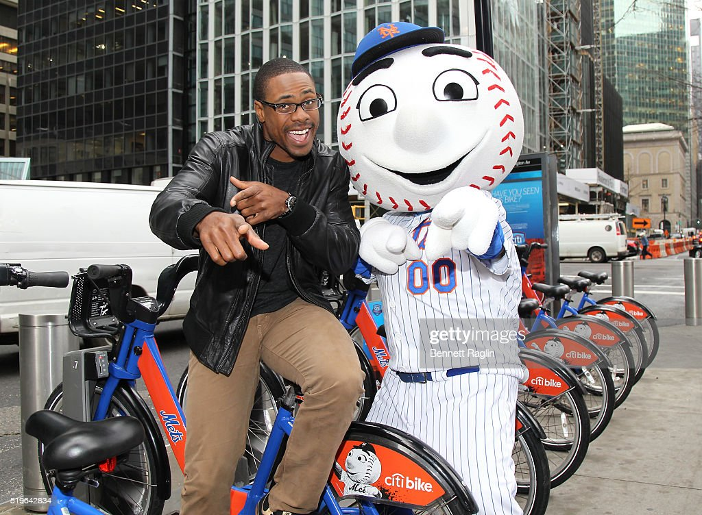 Mets outfielder Curtis Granderson and Mr. Met pose during launch of the Citi Perks Sweepstakes. Mets outfielder Curtis Granderson helped Citi launch the Citi Perks Sweepstakes in midtown today, with 350 bikes from Citi Bike with Mets-themed branding across New York City. on April 7, 2016 in New York City.