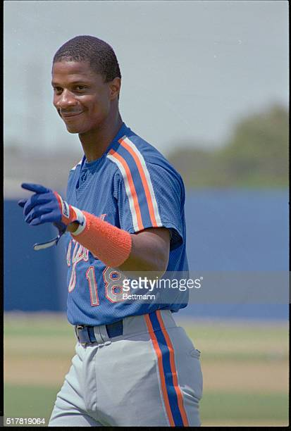 Mets outfielder Darryl Strawberry gestures and smiles as he heads to the dugout before the Mets game 3/9 with the Baltimore Orioles. Strawberry is...