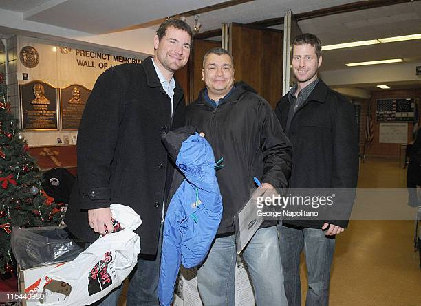 NY Mets pitchers Mike Pelfrey and John Maine with George Amores who donated a coat to the 20th Annual New York Cares Coat Drive at NYPD's 13th...