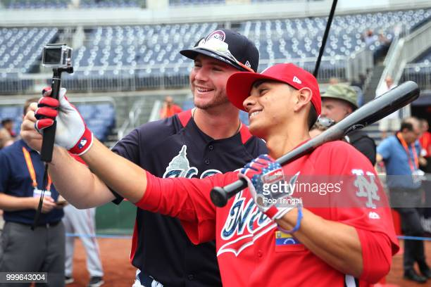 Mets prospects Peter Alonso of Team USA and Andres Gimenez of the World Team take a photo before the SiriusXM AllStar Futures Game at Nationals Park...