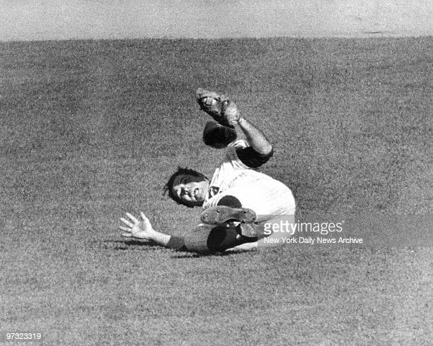 Mets' Ron Swoboda has ball in his glove after making a diving catch of Brooks Robinson's ninthinning liner in the fourth game of the '69 World Series...