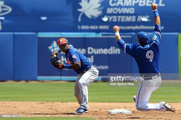 Mets second baseman Dilson Herrera forces out Darrell Ceciliani of the Blue Jays and then turns to make the throw over to first base during the...