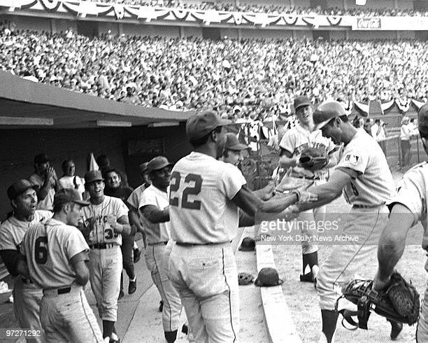 Y Mets vs Atlanta Braves 1969 National League Championship Series Game 1 Mets JC Martin arrives at dugout to receive congrats from teammates in...