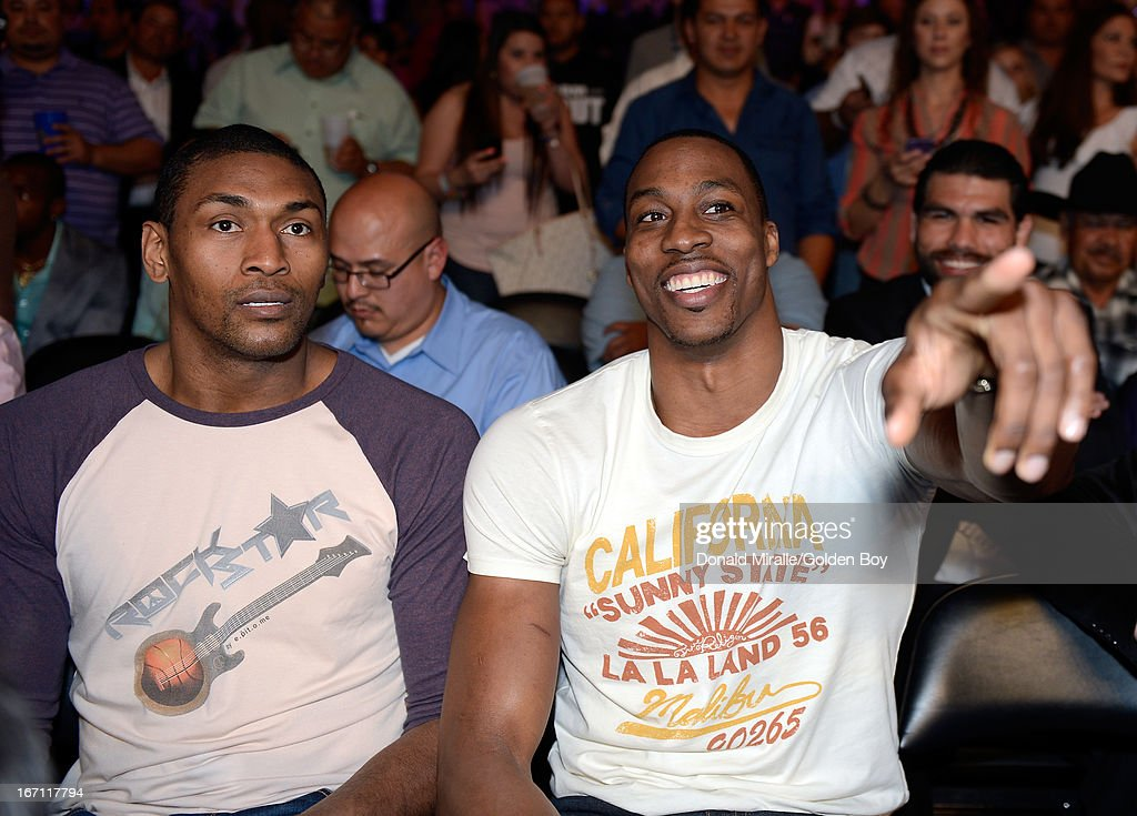Metta World Peace and Dwight Howard of the Los Angeles Lakers look on from the stands during Canelo Alvarez's unanimous 12-round decision over Austin Trout during the WBC, WBA, and Vacant Ring Magazine Super Welterweight Title at Alamodome on April 20, 2013 in San Antonio, Texas.