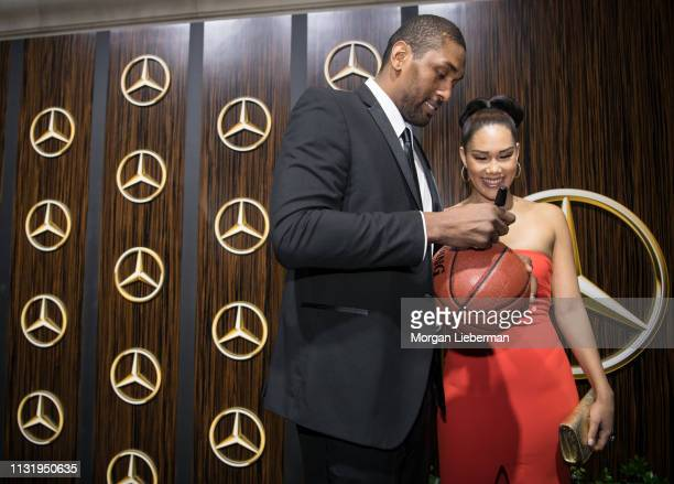 Metta World Peace and Maya Ford arrive at the MercedesBenz USA's Oscars Viewing Party at Four Seasons Hotel Los Angeles at Beverly Hills on February...
