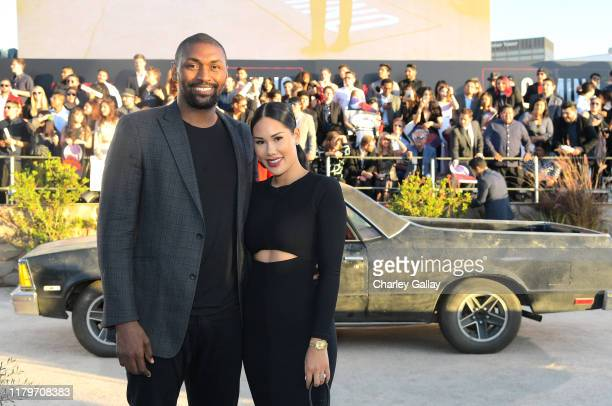 Metta World Peace and Maya Ford attend the World Premiere of El Camino A Breaking Bad Movie at the Regency Village on October 07 2019 in Los Angeles...