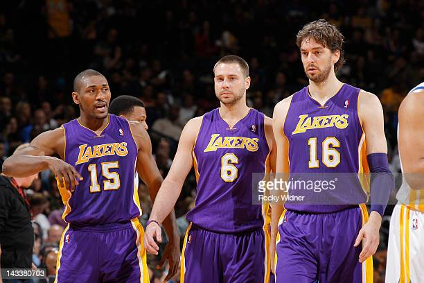 Metta World Peace Josh McRoberts and Pau Gasol of the Los Angeles Lakers face off against the Golden State Warriors on April 18 2012 at Oracle Arena...