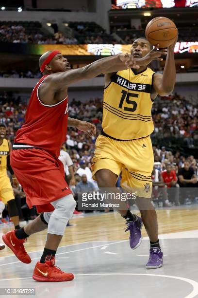 Metta World Peace of the Killer 3s drives to the basket against Al Harrington of Trilogy during week nine of the BIG3 threeonthree basketball league...