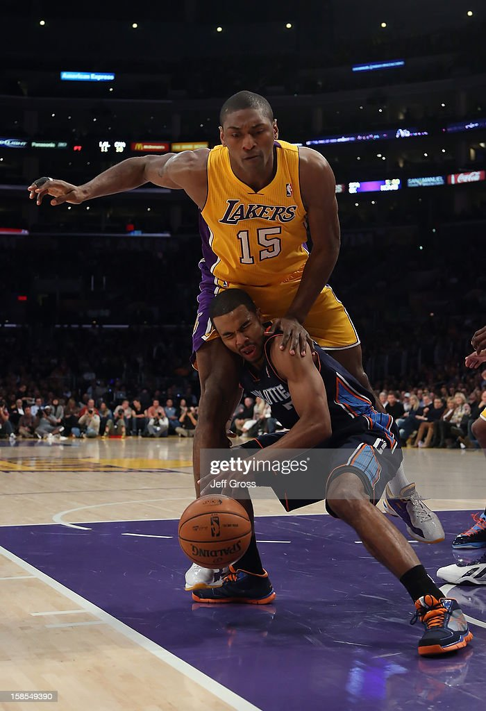 Metta World Peace #15 of the Los Angeles Lakers and Ramon Sessions #7 of the Charlotte Bobcats get tangled up in the second half at Staples Center on December 18, 2012 in Los Angeles, California. The Lakers defeated the Bobcats 101-100.