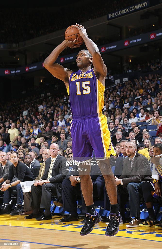 Metta World Peace #15 of the Los Angeles Lakers attempts a three pointer against the Golden State Warriors on December 22, 2012 at Oracle Arena in Oakland, California.