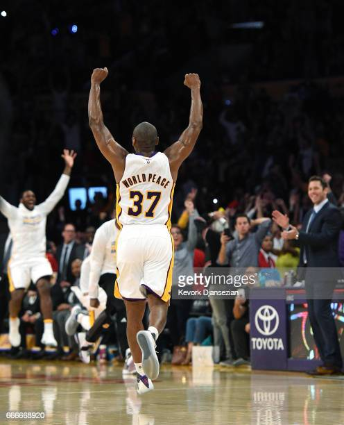 Metta World Peace of the Los Angeles Lakers celebrates the buzzerbeating threepoint basket by teammate D'Angelo Russell of the Los Angeles Lakers to...