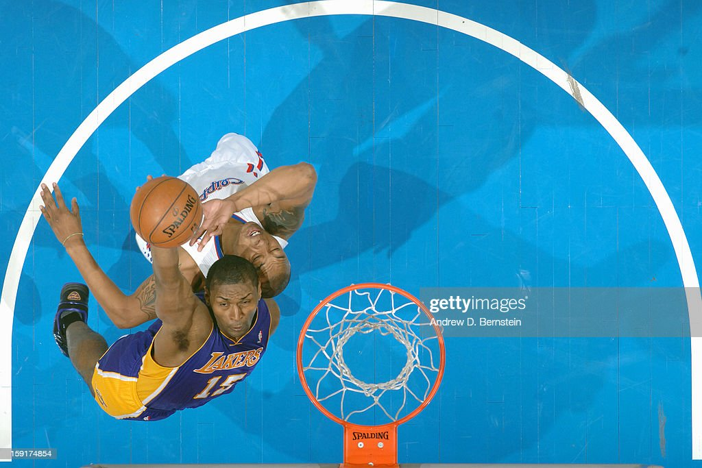 Metta World Peace #15 of the Los Angeles Lakers goes up for the tip against the Los Angeles Lakers at Staples Center on January 4, 2013 in Los Angeles, California.