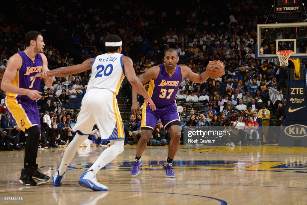 Metta World Peace #37 of the Los Angeles Lakers handles the ball against the Golden State Warriors on April 12, 2017 at ORACLE Arena in Oakland, California.