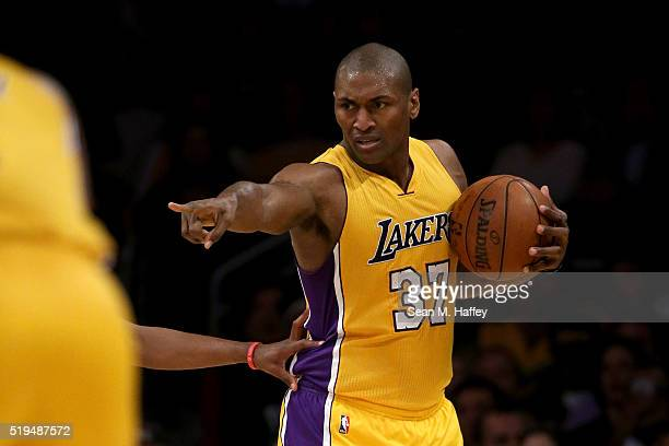Metta World Peace of the Los Angeles Lakers points to a teammate during the first half of an NBA game against the Los Angeles Clippers on April 6,...