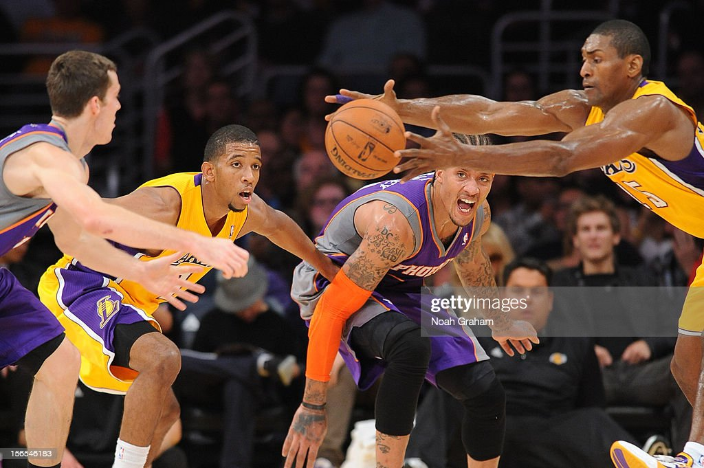 Metta World Peace #15 of the Los Angeles Lakers reaches for the ball against Michael Beasley #0 of the Phoenix Suns at Staples Center on November 16, 2012 in Los Angeles, California.