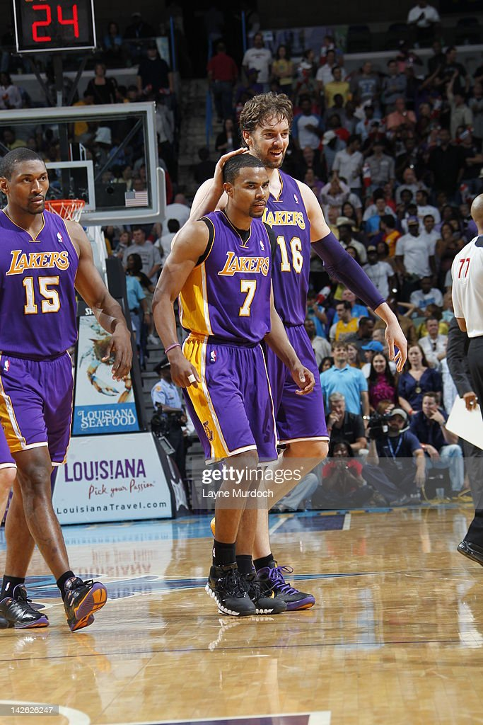 Metta World Peace #15, Ramon Sessions #7 and Pau Gasol #16 of the Los Angeles Lakers celebrate against the New Orleans Hornets on April 9, 2012 at the New Orleans Arena in New Orleans, Louisiana.