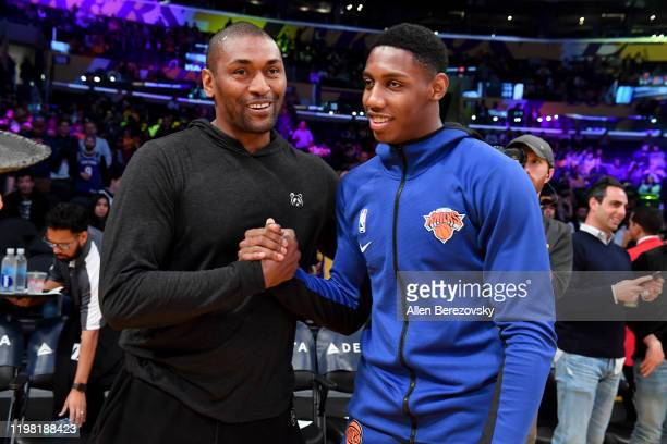 Metta World Peace talks to RJ Barrett Jr. Prior to a basketball game between the Los Angeles Lakers and the New York Knicks at Staples Center on...