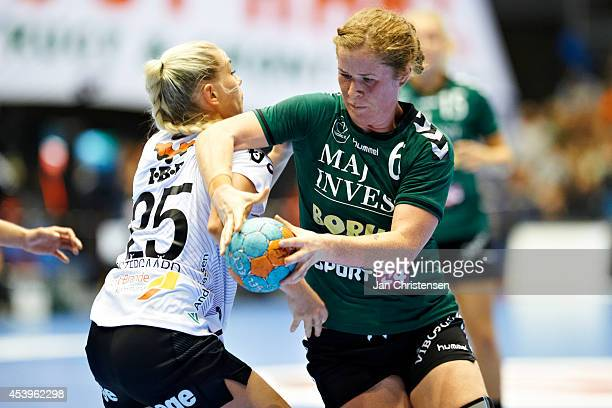 Mette Gravholt of Viborg HK challenge for the ball during Super Cup Final between Viborg HK and FC Midtjylland in Gigantium on August 22 2014 in...