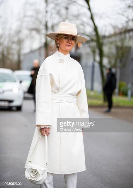 Mette Sorrig is seen wearing hat, white coat, boots outside Lala Berlin during Copenhagen Fashion Week Autumn/Winter 2020 Day 3 on January 30, 2020...