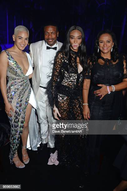 Mette Towley Chris Tucker Winnie Harlow and Isabel dos Santos attend the amfAR Gala Cannes 2018 dinner at Hotel du CapEdenRoc on May 17 2018 in Cap...
