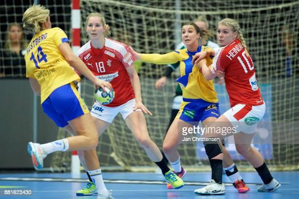 Mette Tranborg of Denmark and Kathrine Heindahl of Denmark defending during the friendly match between Denmark and Sweden in Arena Nord on November...