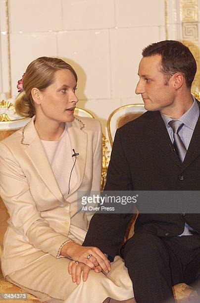 Mette-Marit Tjessem and HRH Crown Prince Haakon Magnus hold hands January 21, 2000 after announcing their engagement in Oslo, Norway. The couple...