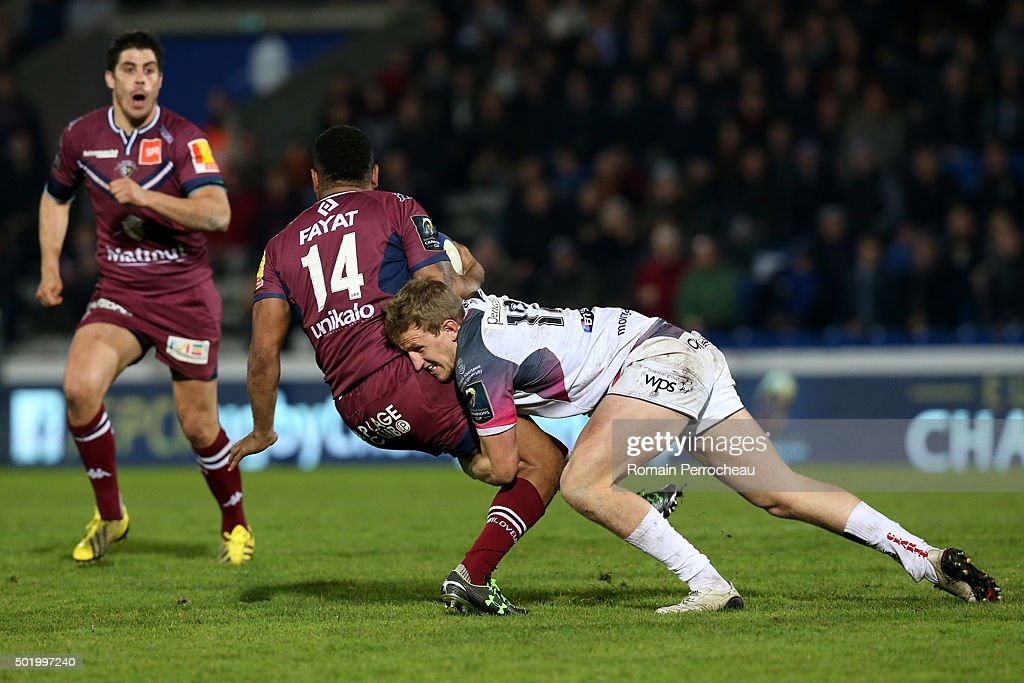 Metuisela Talebula for Union Bordeaux Begles (L) is tackled by Ben John for Ospreys during the European Rugby Champions Cup match between Union Bordeaux Begles and Ospreys at Stade Chaban-Delmas on December 19, 2015 in Bordeaux, France.