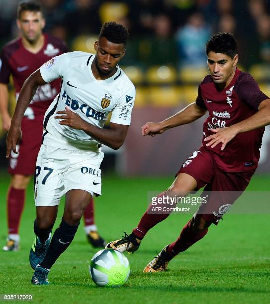 Metz' Argentinian midfielder Geronimo Poblete vies with Monaco's French midfielder Thomas Lemar during the French L1 football match between Metz and...