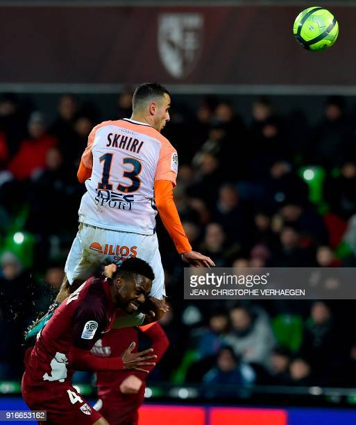 Metz' Cameroonian defender Georges Mandjeck vies for the ball with Montpellier's French midfielder Ellyes Skhiri during the French L1 football match...
