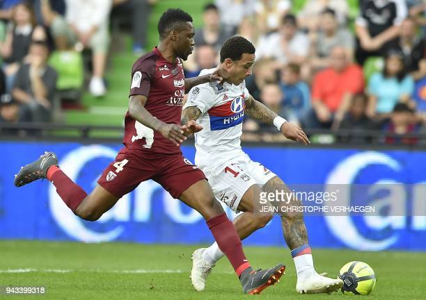 Metz' Cameroonian defender Georges Mandjeck vies with Lyon's Dutch forward Memphis Depay during the French L1 football match between Metz and Lyon on...