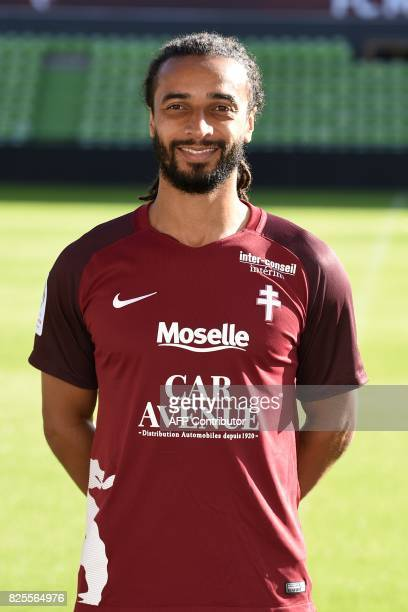 Metz' CameroonianFrench defender Benoit AssouEkotto poses for the French L1 20172018 football season official portrait on August 2 2017 at...